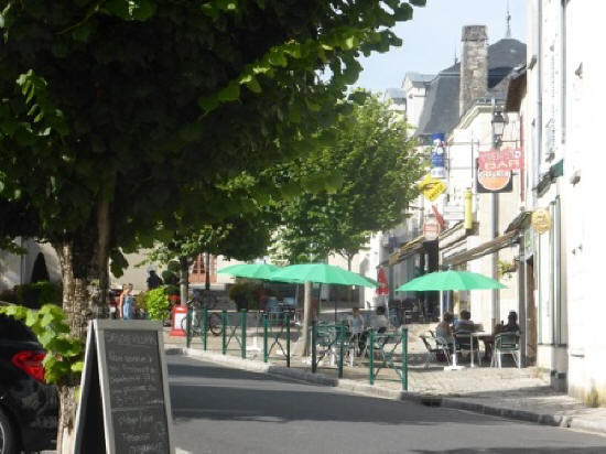 tables and chairs in front of cafes in Le Grand-Pressigny
